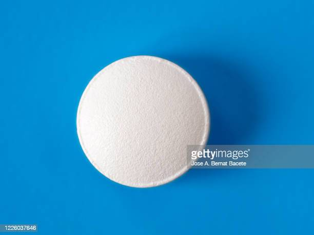 medicine pill on a blue background. - capsule stock pictures, royalty-free photos & images