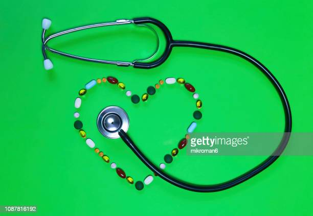 Medicine pills and Capsules forming heart shape and stethoscope, Medical concept