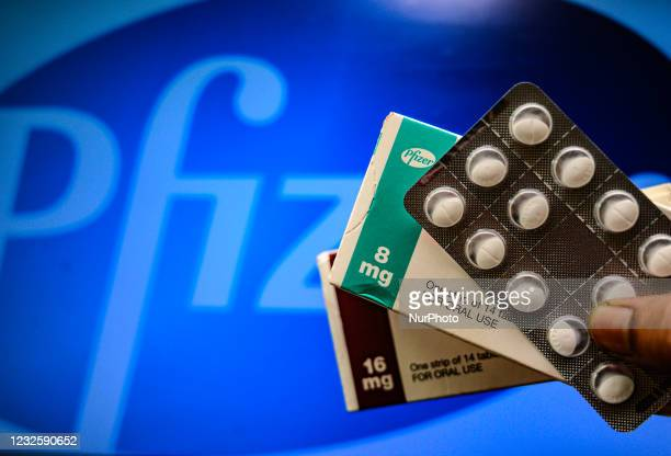 Medicine pills are seen with Pfizer logo in this illustration photo taken in Tehatta, West Bengal, India on 29 April 2021. New York-based...