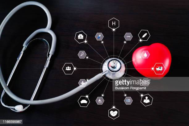 medicine. stethoscope with red heart and icon medical network connection on wooden. virtual technology concept. - medical icons stock pictures, royalty-free photos & images