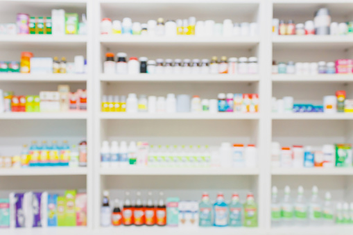 medicines arranged on shelves in the pharmacy blurred background 840692780