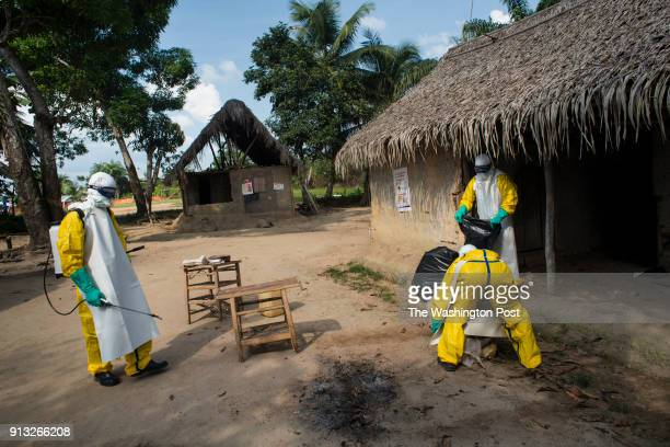 Medicins Sans Frontieres workers disinfect a home in Quewein Liberia where a person fell ill with Ebola on Thursday December 11 2014
