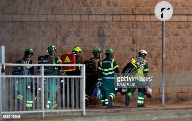 Medics and rescuers in Manchester Britain deploy May 22 after reports of an explosion at the Manchester Arena British police said early May 23 there...