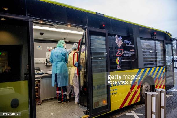 Medics are seen as the transport from IC to IC is done with a Mobile Intensive Care Unit at the Amphia Hospital in Breda on March 20 2020 The...