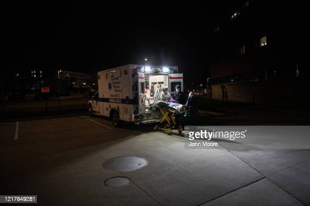 Medics arrive to Stamford Hospital with a patient with possible COVID19 symptoms on April 03 2020 in Stamford Connecticut In normal times many...
