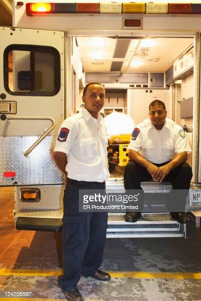 Medics at rear of ambulance