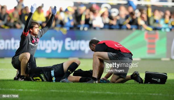 Medics call for a stretcher after Camille Lopez of Clermont Auvergne injures his left leg during the European Rugby Champions Cup match between ASM...