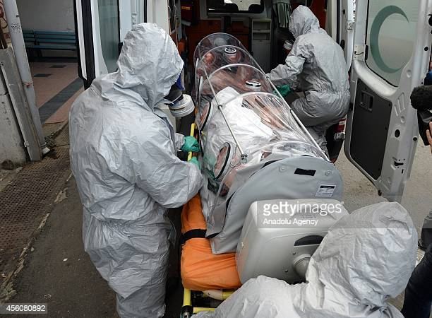 Medics carry a Nigerian patient Fabian Chiman Egeolu suspected of being infected with the Ebola virus during his transfer to another hospital in...