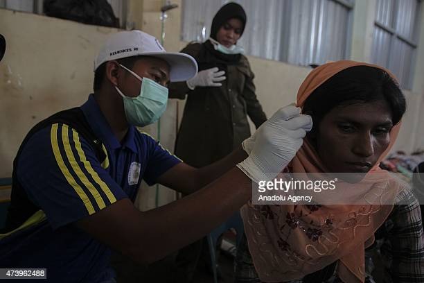 Medics check up health of migrants from Myanmar at camp shelters in the fishing port of Kuala Langsa in Aceh province May 19 2015 Hundreds of...