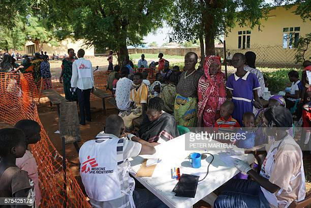 TOPSHOT Medics from aid agency Doctors Without Borders treat patients at a makeshift clinic in the grounds of the Catholic Cathedral in the South...