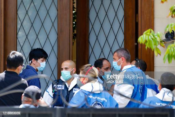 Medics gather in front of the residence of Israel's Chinese ambassador after he was reportedly found dead on May 17, 2020. - The Chinese ambassador...