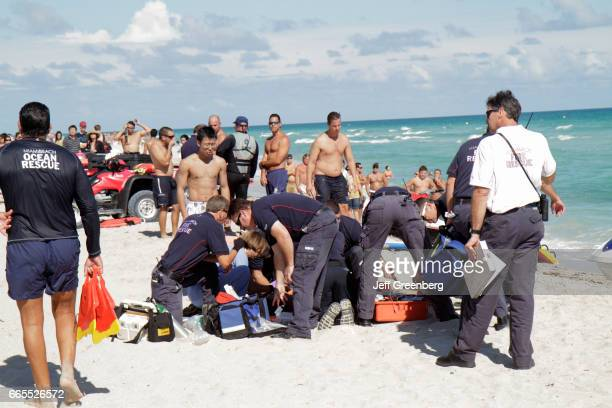 Medics helping a drowning victim on Miami Beach