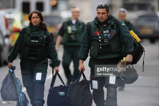 Medics leave the scene near the scene of last night's London Bridge terrorist attack on June 4 2017 in London England Police continue to cordon off...