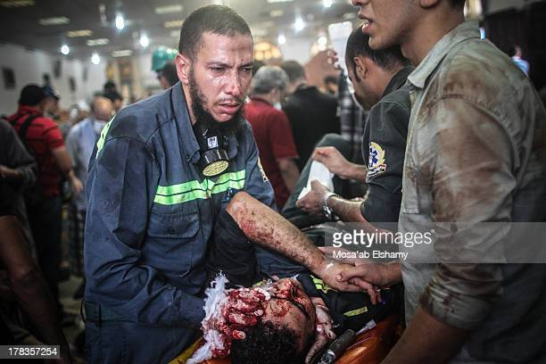 CONTENT] Medics stand next to their killed colleague in a makeshift hospital A man grieves as he looks at one of many bodies laid out in a make shift...