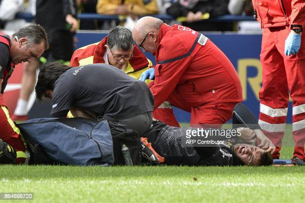 Medics tend to Clermont's French flyhalf Camille Lopez after he suffered a broken shinbone to his left leg during the European Rugby Champions Cup...