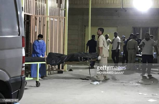 Medics transport one of the victims of a bomb blast to a hospital in the Shiite holy Iraqi city of Karbala, 100kms south of the capital Baghdad on...