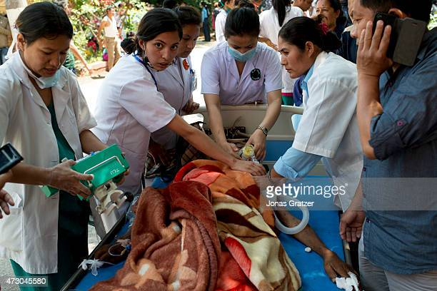 Medics treat an injured person at Police Hospital in Kathmandu following a further major earthquake on May 12 2015 in Kathmandu Nepal A 73 magnitude...