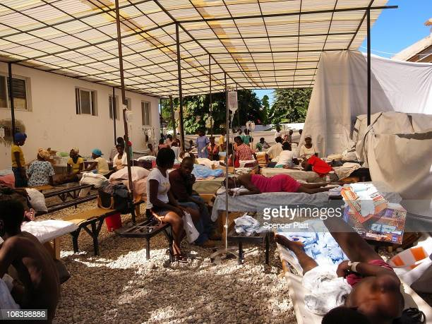 Medics treat cholera patients at a hospital run by the Haitian government where Doctors Without Borders is treating people with cholera October 30...
