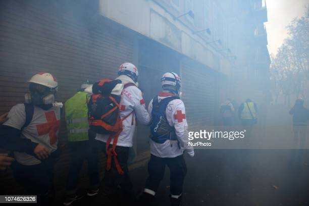 Medics walk amid clouds of tear gas Act VI dubbed 'Revolt' of the Yellow Vest movement begun peacefully but the protest turned rapidly to riots for...