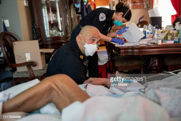 Medics wearing personal protective equipment prepare to intubate a gravely ill patient with COVID19 symptoms at his home on April 06 2020 in Yonkers...