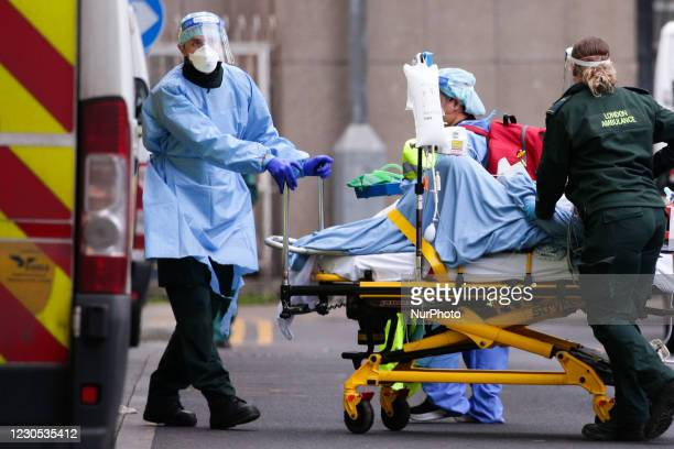 Medics wearing PPE transport a patient into the emergency department of the Royal London Hospital in London, England, on January 11, 2021. Mayor of...