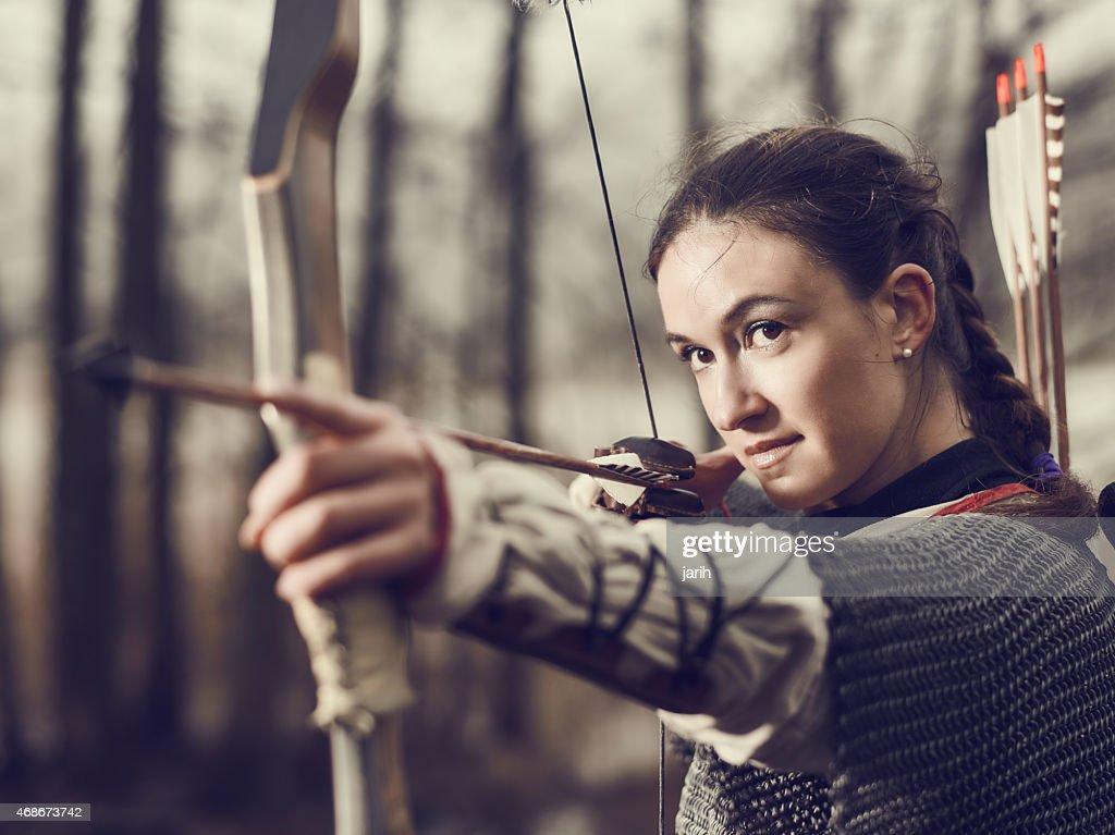 Medieval archery, woman shoot : Stock Photo