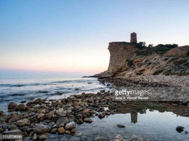 medieval architecture tower on the coast of the village of villajoyosa. spain. - alicante stock pictures, royalty-free photos & images