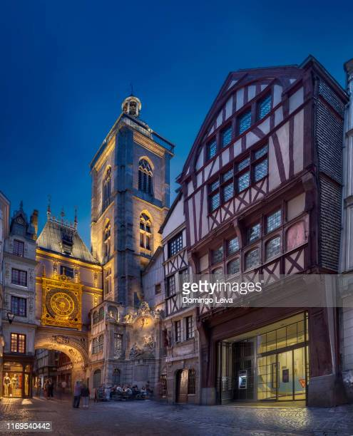 medieval building and clock on gros horloge street in rouen, france - rouen stock pictures, royalty-free photos & images