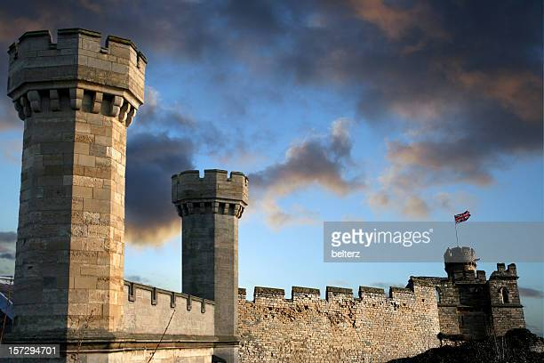 medieval castle against a blue sky - castle wall stock pictures, royalty-free photos & images