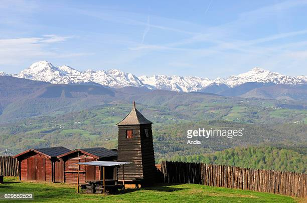 Medieval castle of Mauvezin the fence the wooden watch tower and view of the landscape with the Pyrenees and the Baronnies region on the Way of St...