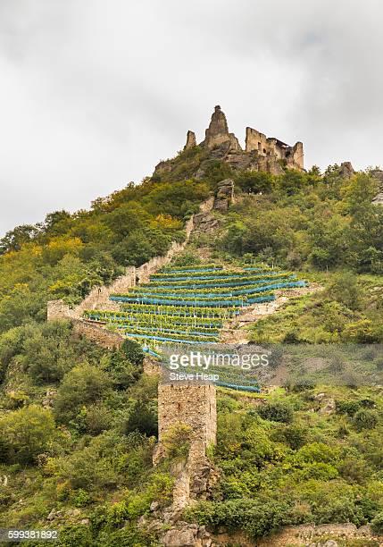 Medieval castle ruins on hillside above town by River Danube in Durnstein, Austria