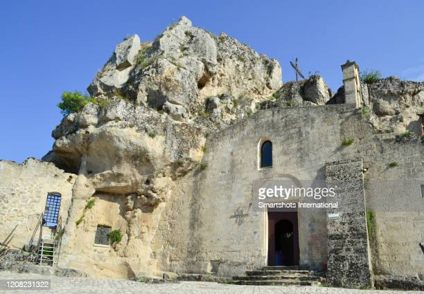 medieval church carved into the rocks of matera's old town in basilicata region, italy - バシリカータ ストックフォトと画像