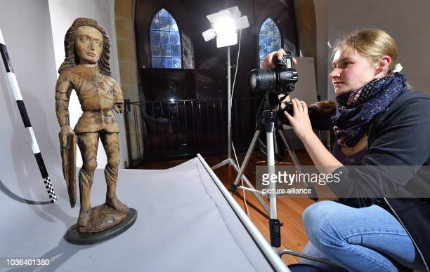 A medieval figure of StGeorge is being photographed and documented by Myra Lueers a student in the Master's program for restoration at the FH Erfurt...
