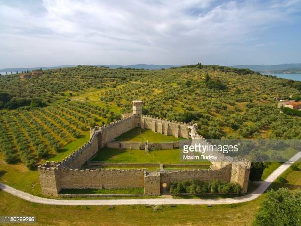 medieval fortress on the trasimeno lake by drone - fortified wall stock pictures, royalty-free photos & images