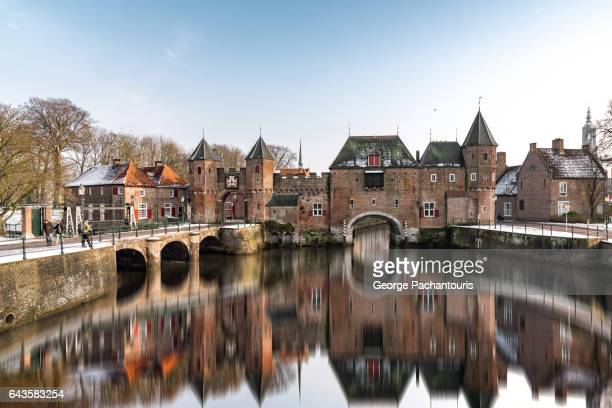 medieval gate of koppelpoort in amersfoort, netherlands - utrecht stock pictures, royalty-free photos & images