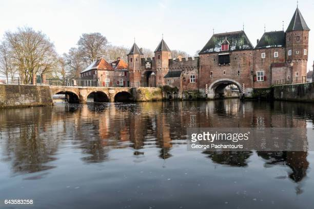 medieval gate of koppelpoort in amersfoort, netherlands - amersfoort netherlands stock photos and pictures
