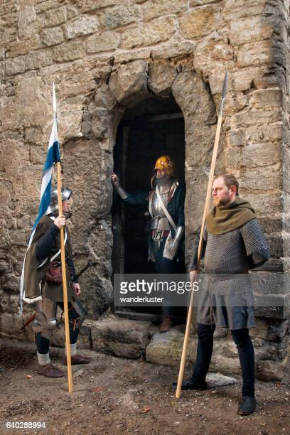 medieval guarded entrance - sword in the stone stock photos and pictures