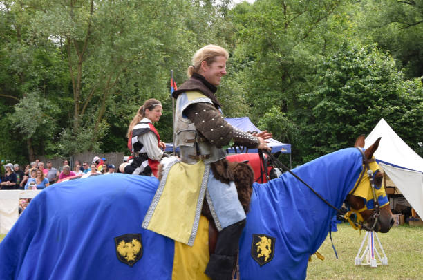 Medieval jousting event of knights on horses in German traditional festival of Hallbergmoos, Munich, Germany