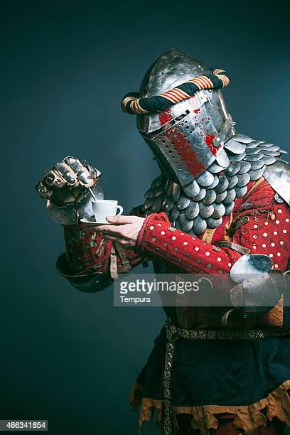Medieval knight dressed for Medieval combat fight sport. Coffee break