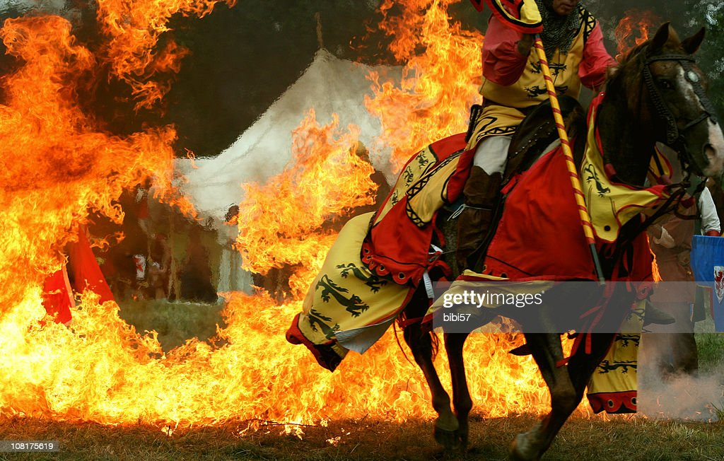 Medieval Knight Horse Jumping Through Ring of Fire : Stock Photo
