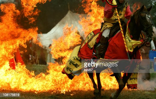 Medieval Knight Horse Jumping Through Ring Of Fire Stock