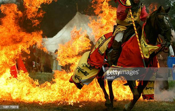 medieval knight horse jumping through ring of fire - historical reenactment stock pictures, royalty-free photos & images