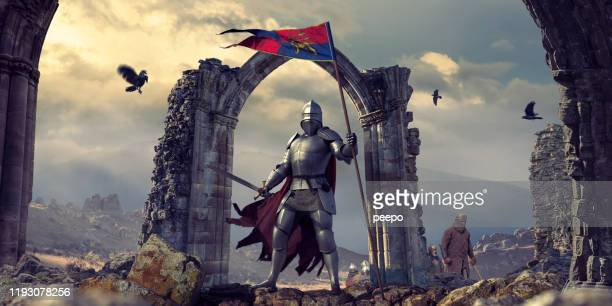 medieval knight in armour with flag and sword near ruins - castle stock pictures, royalty-free photos & images
