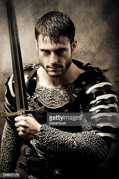 medieval knight in the rain launching an offensive - warrior person stock photos and pictures