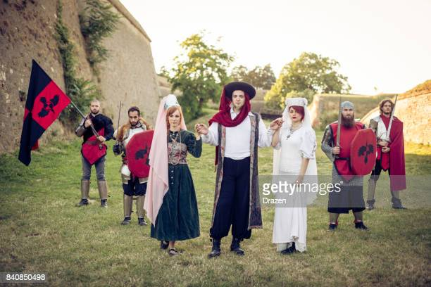 Medieval knights and honor guard with princess and dukes