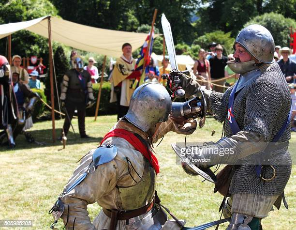 Medieval knights battle fight with armour and swords