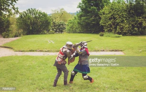 medieval knights fighting on field - reenactment stock photos and pictures