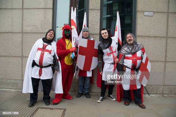 Medieval knights with a dragon in sunglasses on an afternoon pub crawl on St George's Day on 23rd April 2018 in London, England, United Kingdom....