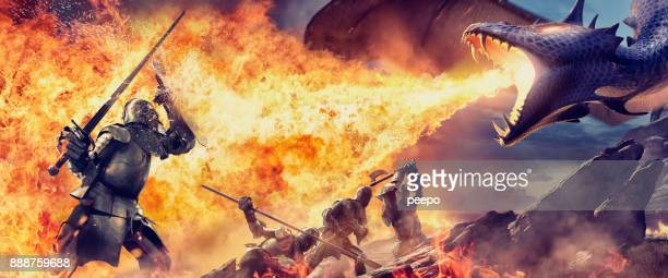 medieval knights with weapons attacked by fire breathing dragon - monster fictional character stock pictures, royalty-free photos & images