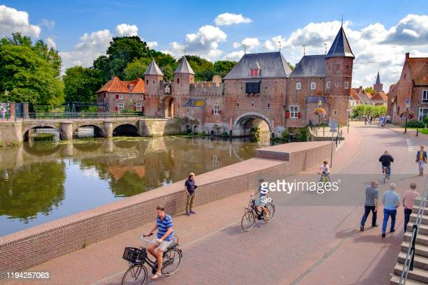 medieval koppelpoort town wall and gate over the eem river in amersfoort - utrecht stock pictures, royalty-free photos & images